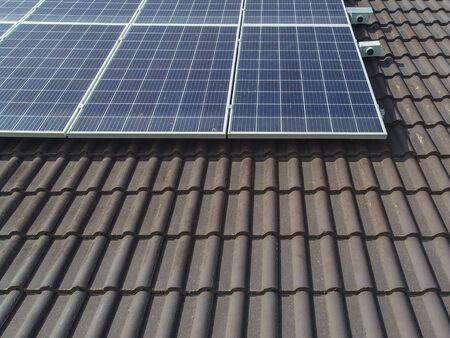 Solar panels on a brown tiled roof