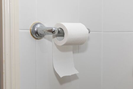 White toilet paper on a chrome hanger Stock Photo - 146454272