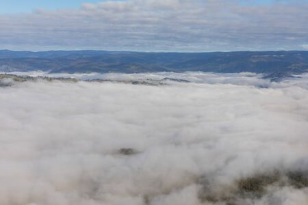 Low level clouds in the Jamison Valley near Katoomba in The Blue Mountains in Australia