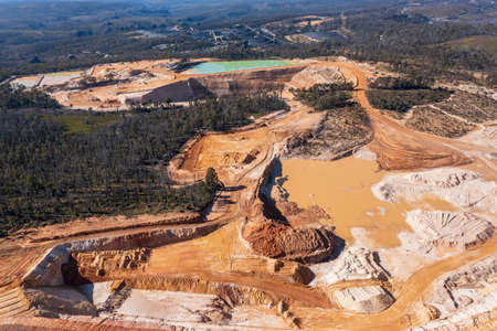 Drone aerial photograph of an industrial Colliery and water reservoirs in a large forest Standard-Bild
