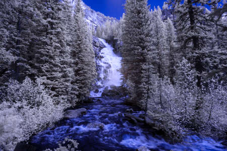 Infrared photograph of fast moving rapids in a fresh water river in the mountains