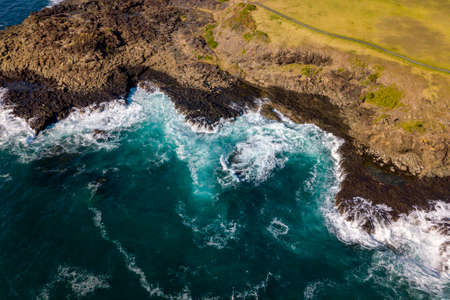 Drone aerial photograph of the ocean crashing against rocks in Kiama on the south coast of New South Wales in Australia