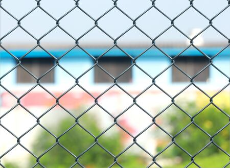Metal fence chain link silver for protected house behind fence