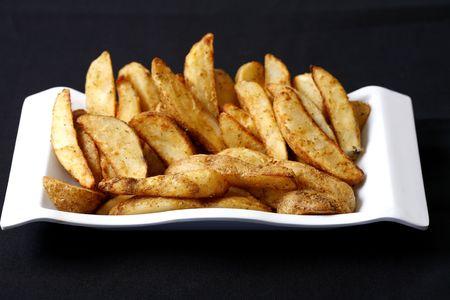 potato wedges Imagens