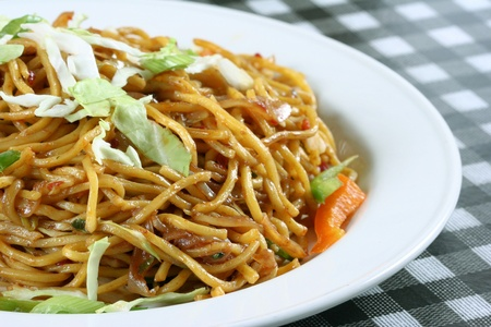 asian noodles: Chowmein in plate with sauce