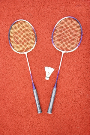 Badminton racket on track ground photo