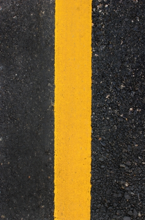 Yellow line on the road texture Stock Photo