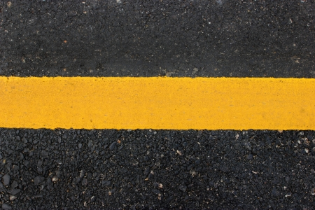 Yellow line on road texture Stock Photo