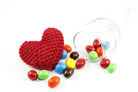 Candy and heart on white background Stock Photo