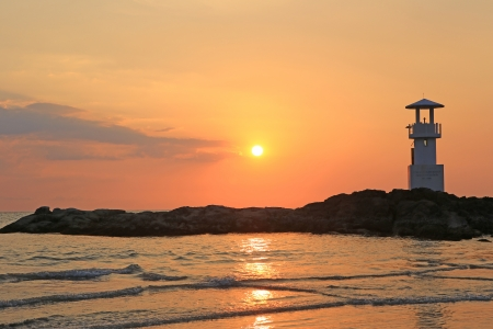 Lighthouse with sunset of thailand sea photo