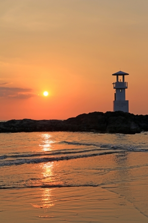 Lighthouse with sunset of thailand sea