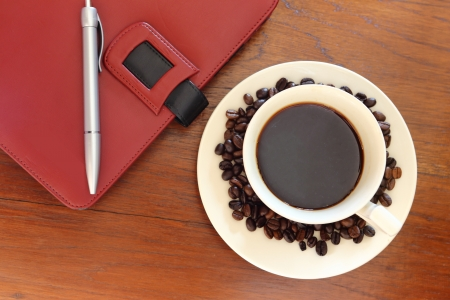 coffee cup with note book on grunge wood Stock Photo - 18207075
