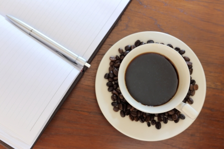 coffee cup with note book on grunge wood Stock Photo - 18207043