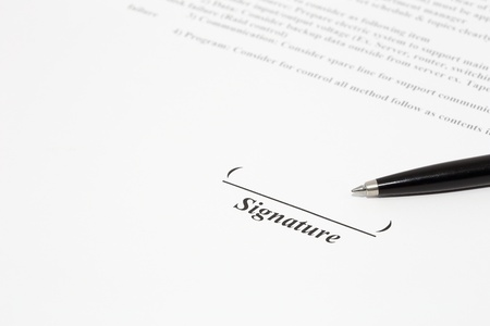 autographing: Sign document with black pen