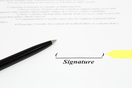 autographing: Sign name on document with black pen