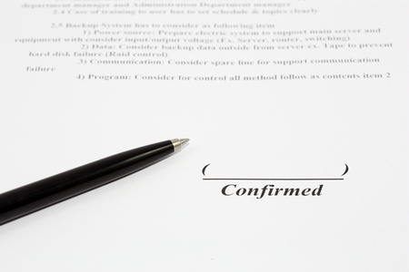 Sign name on document with black pen photo