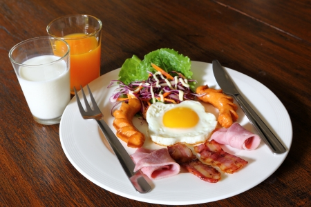 Breakfast with bacon, fried egg,sausages on grunge wood Stock Photo - 18262619
