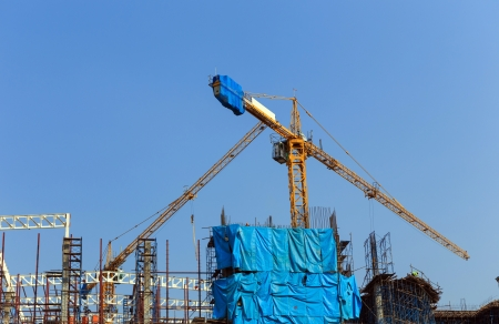 Crane working in construction site photo