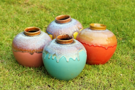Color jars on green grass Stock Photo
