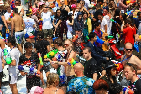 play popular: CHIANGMAI THAILAND-APRIL 13:Chiang Mai Songkran festival. Water gun are popular for play water fighting in the tourism festival.on April 13,2013 in Chiang Mai,Thailand.