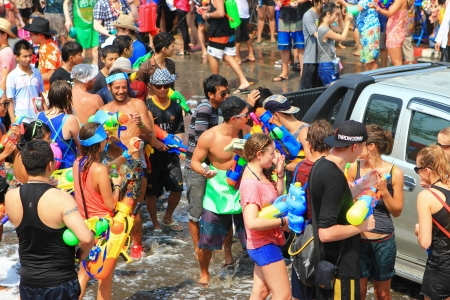 play popular: CHIANGMAI THAILAND-APRIL 13 Chiang Mai Songkran festival  Water gun are popular for play water fighting in the tourism festival on April 13,2013 in Chiang Mai,Thailand   Editorial