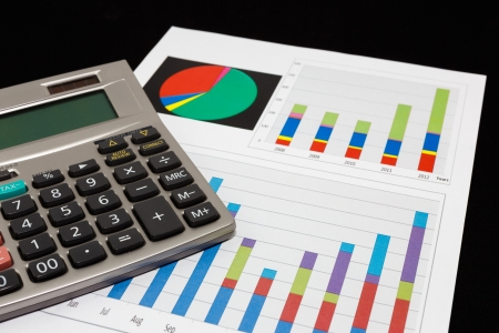 Business report  graph with pen and calculator  photo