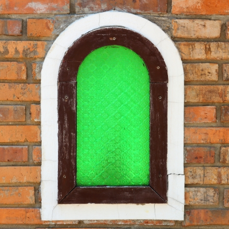 Green window on the wall brick photo