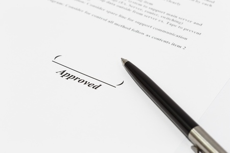 sign document with black pen photo
