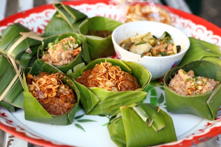 thai food with banaba leaf pack photo