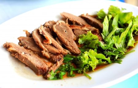 Roast duck on white dish