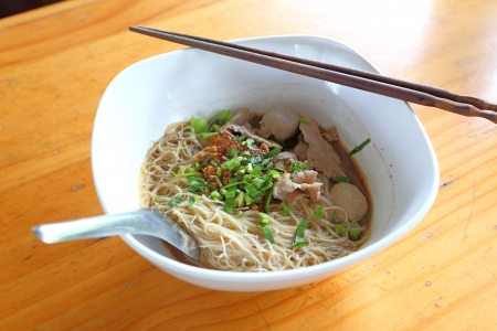 Delicious thai noodle on wood table photo