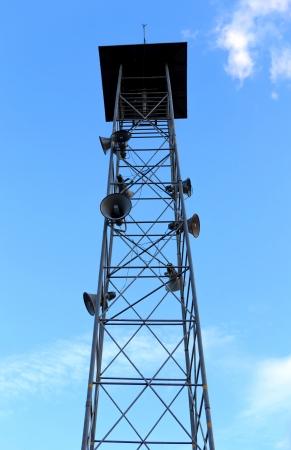 Speaker tower on blue sky photo