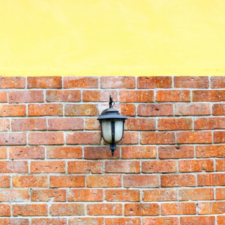 lantern for light on brick wall photo