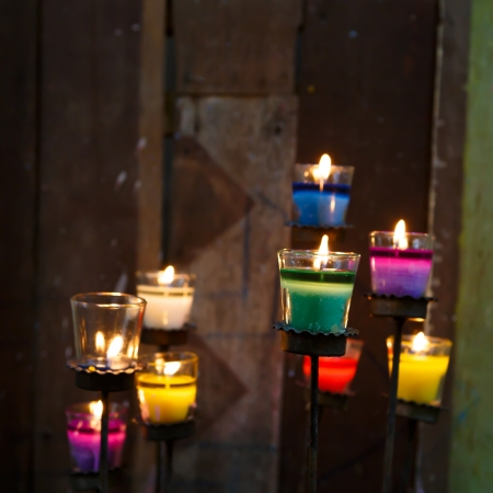 colorful candles in the glass photo