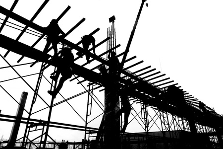 silhouette labor working in construction site Stock Photo