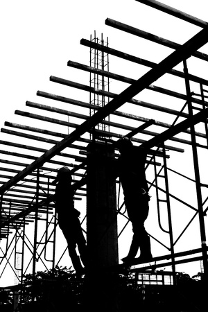 silhouette labor working in construction site photo