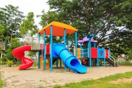 Modern kids toy playground in park Stock Photo - 21297429