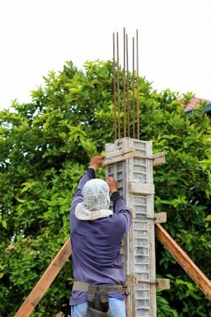 building cement pillar for home construction photo