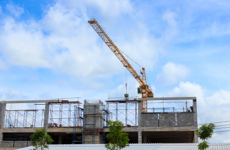 Crane working in construction on blue sky photo