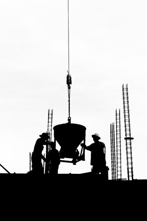 silhouette labor cement working in construction site