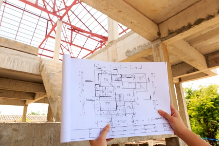 architecture drawings in hand on house building 版權商用圖片