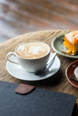 hot coffee with cake on grunge wood background Stock Photo - 23255754