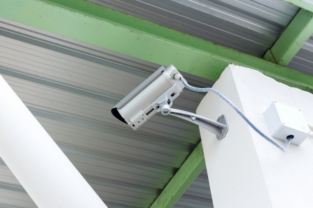 security camera cctv under roof in factory photo