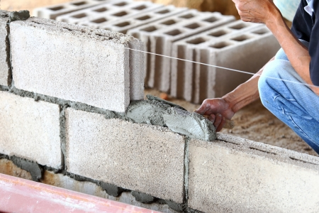 concrete block: Brick wall construction for house building  Stock Photo