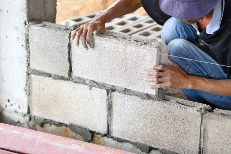 Brick wall construction for house building  Archivio Fotografico