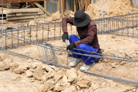 worker prepare steel rod for construction job  photo