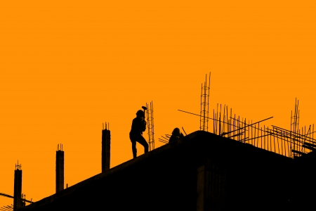 silhouette labor working in construction site