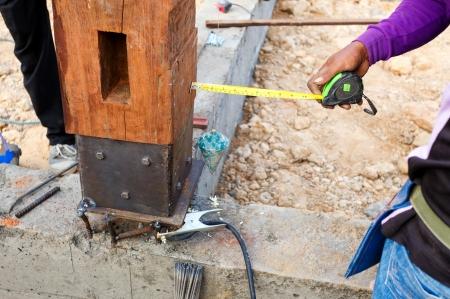 plumb: labor man using a plumb bob for check pillar