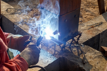 welding metal and wood by electrode with bright electric arc photo