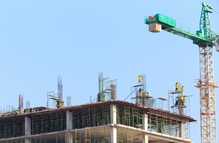 Construction Site with worker on blue sky photo